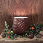 Leather candle with reusable casing
